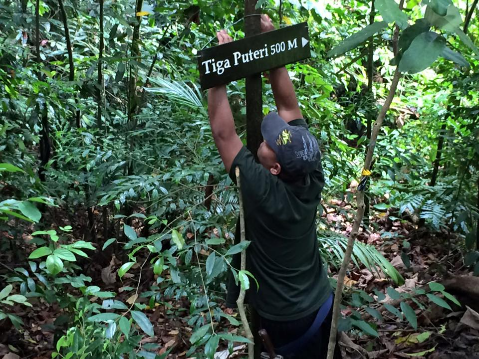 Azlan_placing signage on new trail